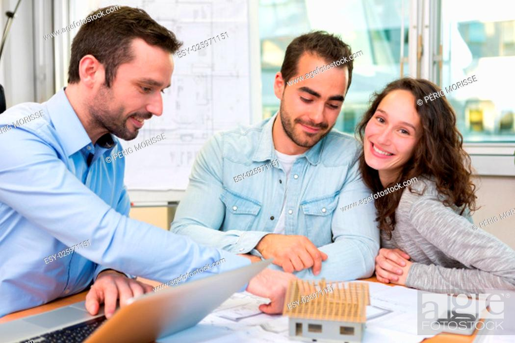 Stock Photo: View of a Young attractive people meeting real estate agent at the office.