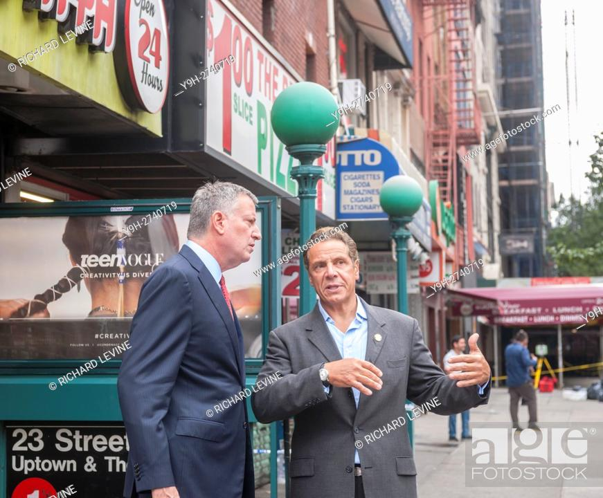 Stock Photo: New York Mayor Bill de Blasio, left, and New York State Governor Andrew Cuomo visit the site of the previous night's bombing in the Chelsea neighborhood of New.