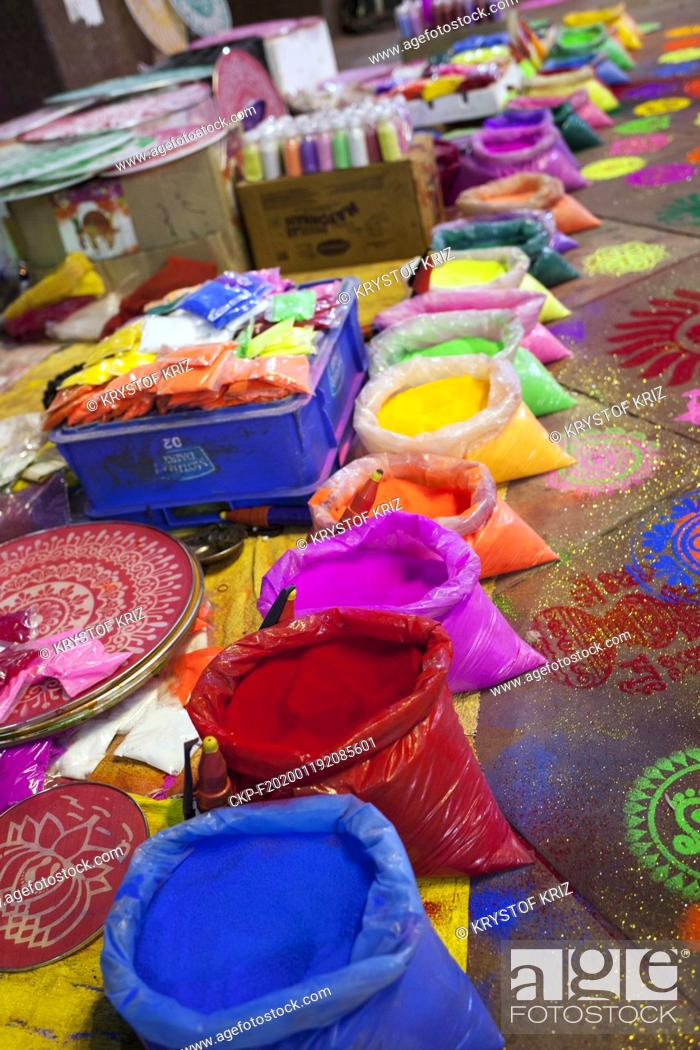 Stock Photo: Pigments of colors and screens for colouring pictured at the street market in New Delhi, India on 23 October 2019. These pigments and screens are used for.