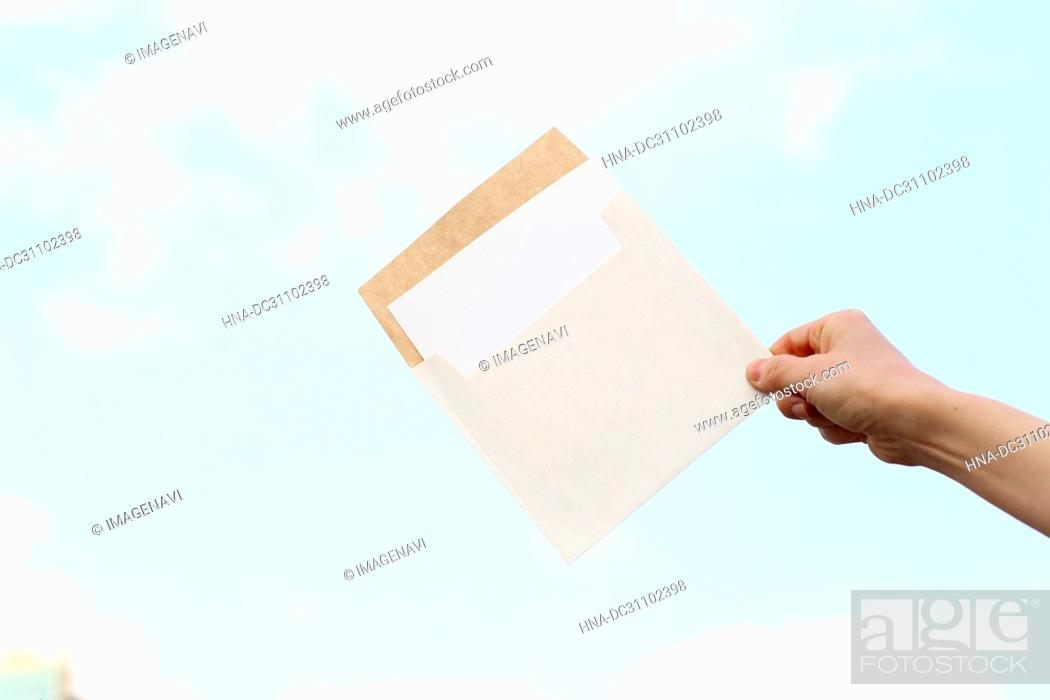 Stock Photo: Woman Hand Holding Envelope.