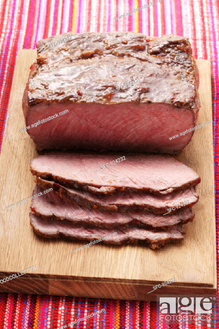 Stock Photo: Roast beef on chopping board.