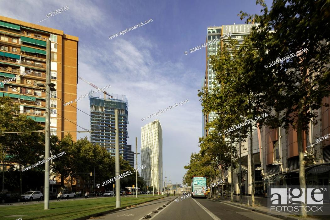 Stock Photo: Building under construction and Telefonica Headquarters. building at Diagonal Mar district, Barcelona, Catalonia, Spain.
