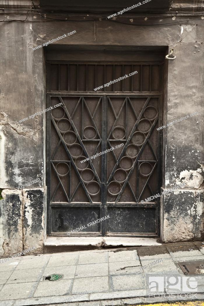 Stock Photo: Ornate door of old townhouse in Granada, Spain.