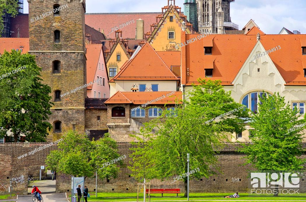 Stock Photo: Ulm, Germany - view of the historic waterfront at the river Danube showing the city walls, conservatoire, Leaning Tower, townhall and cathedral.