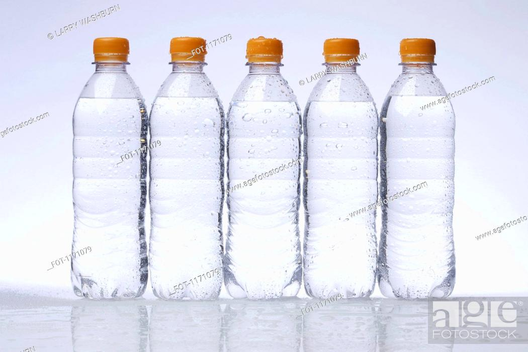Stock Photo: A row of five full plastic water bottles in a row.