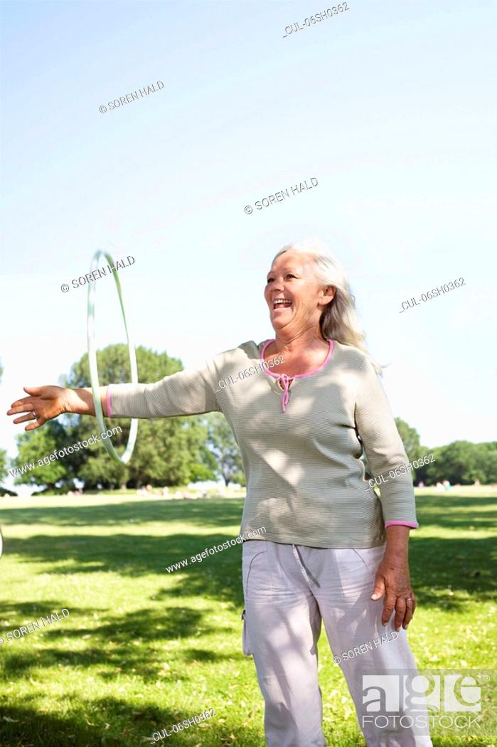 Stock Photo: Mature woman with hula-hoop.