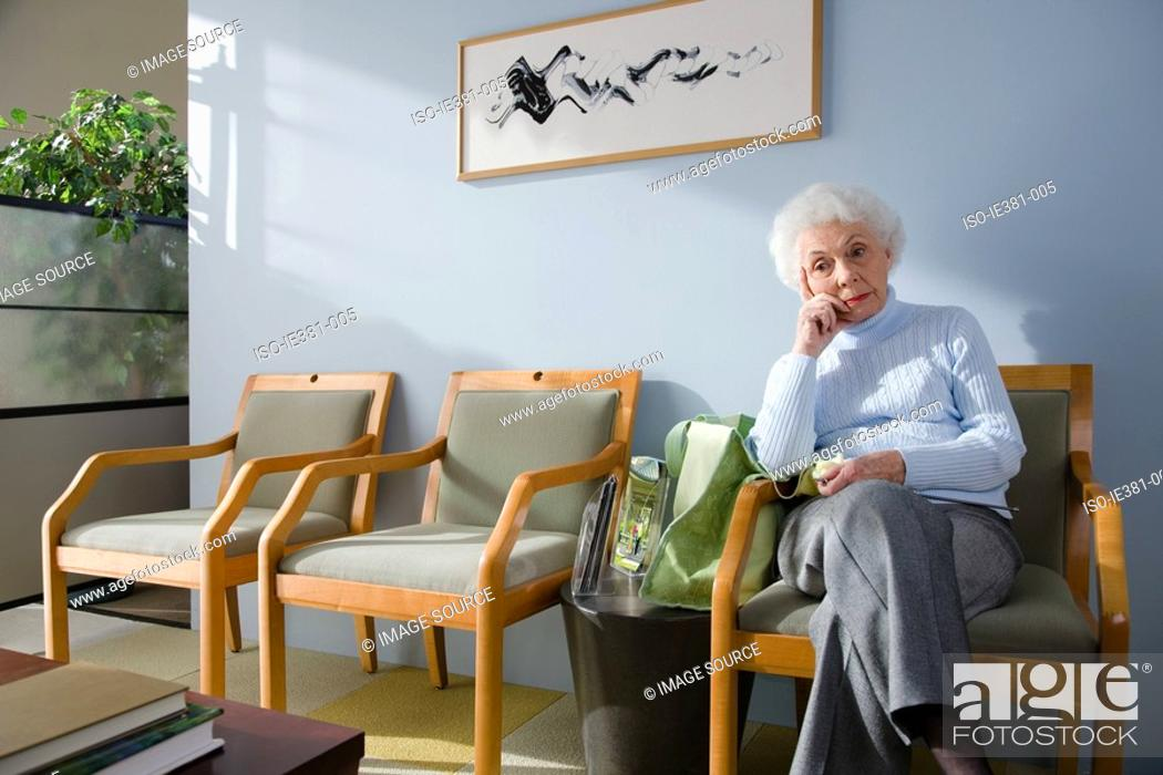 Stock Photo: A senior woman waiting in a doctors office.
