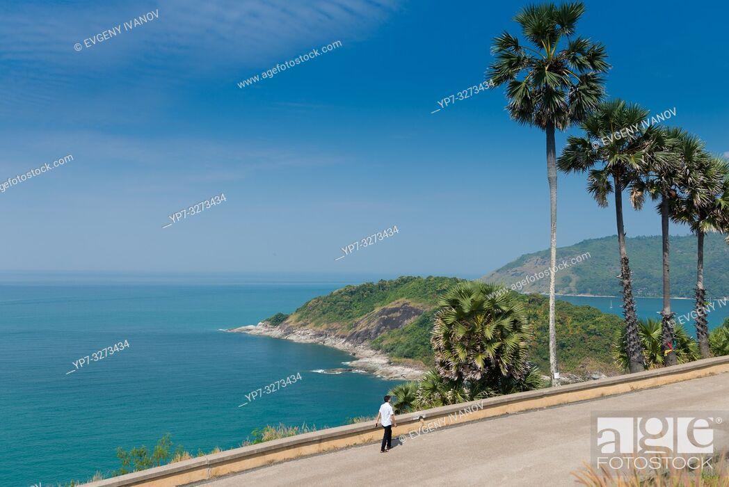 Stock Photo: Tourist walking along the sea on Promthep Cape, Phuket, Thailand.
