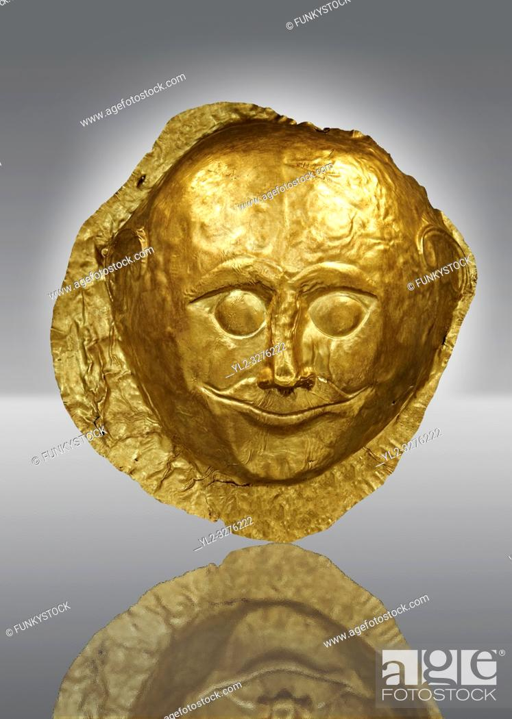 Stock Photo: Gold Death Mask from Grave V, Grave Circle A, Mycenae. The mask is made of a thin sheet of beaten gold and is the only mask from grave circle A with eyes open.