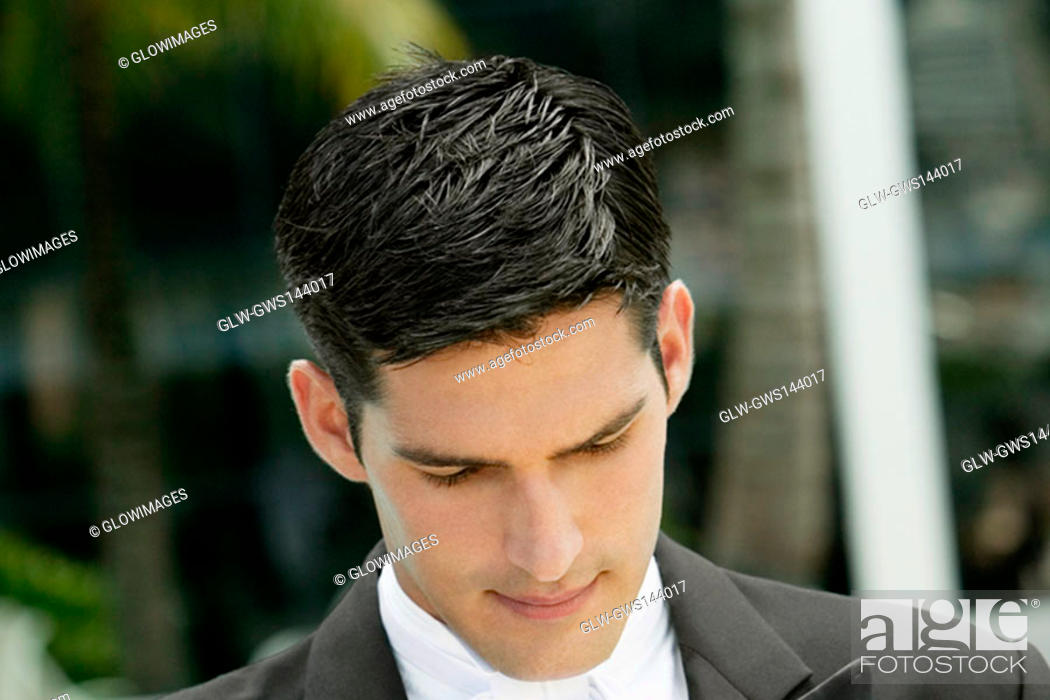 Stock Photo: Close-up of a groom looking down.