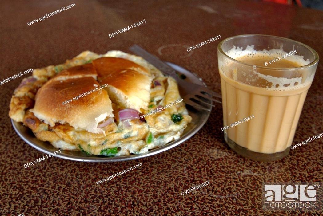 Stock Photo: Breakfast omelette and bread with masala tea ; Dehradun ; Uttaranchal ; India.