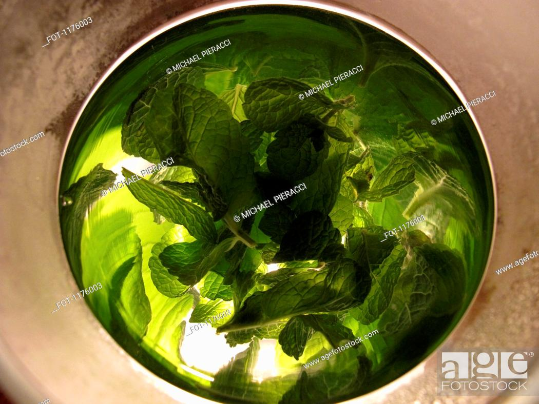 Stock Photo: Distorted reflections of fresh mint in silver bowl.