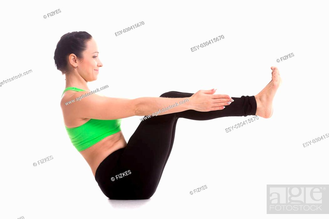 Smiling Sporty Beautiful Girl Practices Yoga Sitting In Boat Pose Navasana Strengthens Abdomen Stock Photo Picture And Low Budget Royalty Free Image Pic Esy 030415670 Agefotostock
