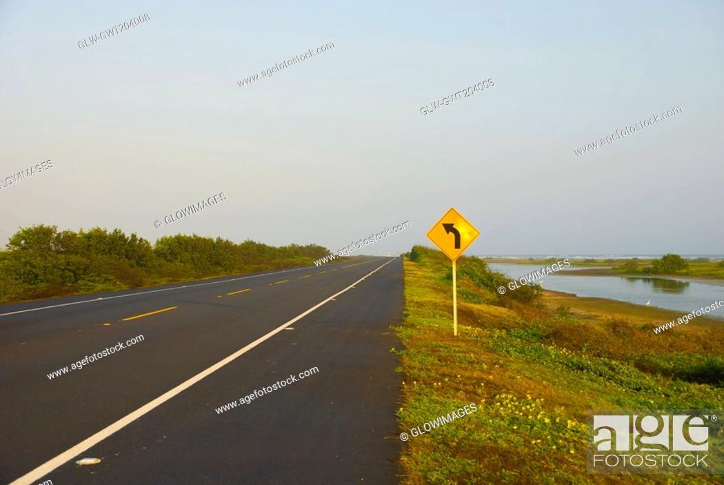 Stock Photo: Direction sign near the road, Cienaga, Atlantico, Colombia.