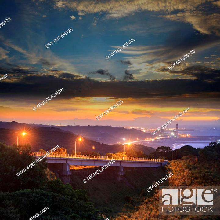 Stock Photo: The beautiful sunset with a bridge over sea.
