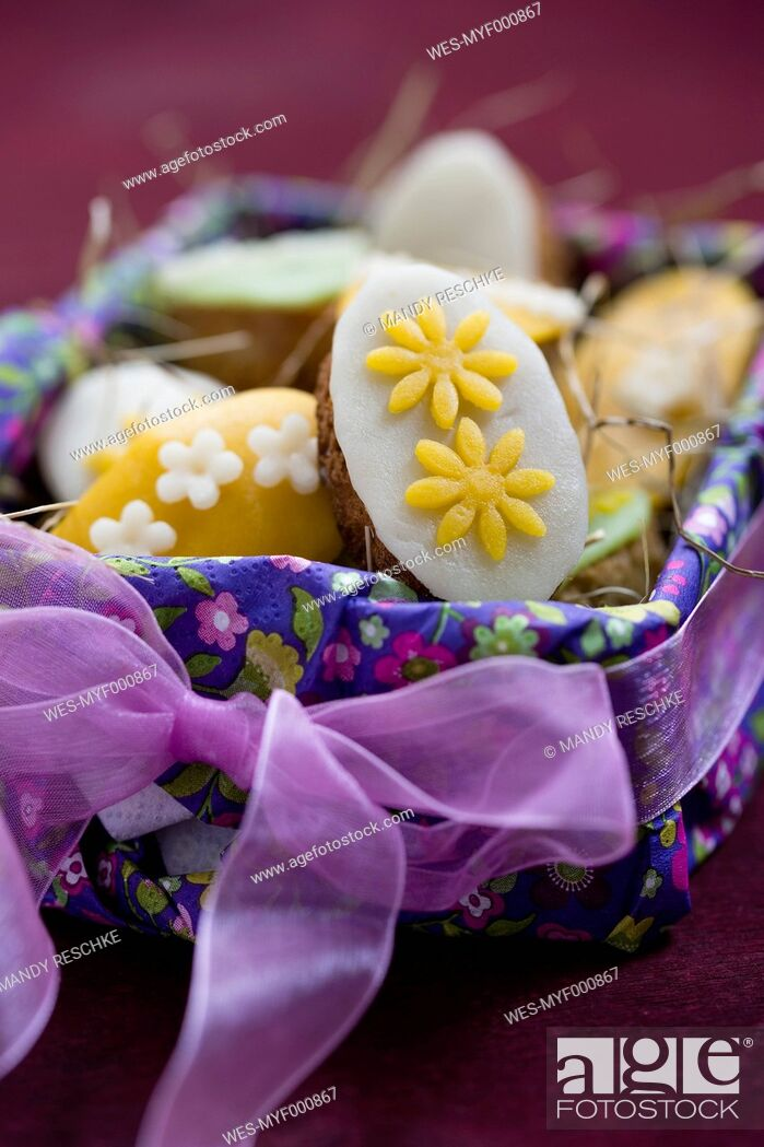 Stock Photo: Easter basket with mini cakes decorated with marzipan.