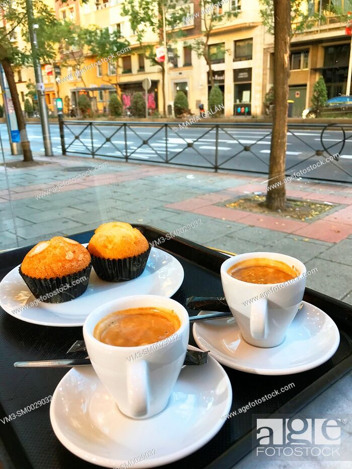 Imagen: Two cups of coffee with muffins in a cafeteria. Madrid, Spain.