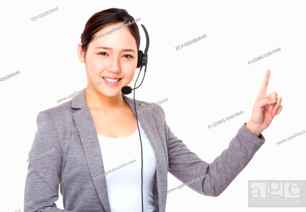 Stock Photo: Telemarketing operator and finger point up.