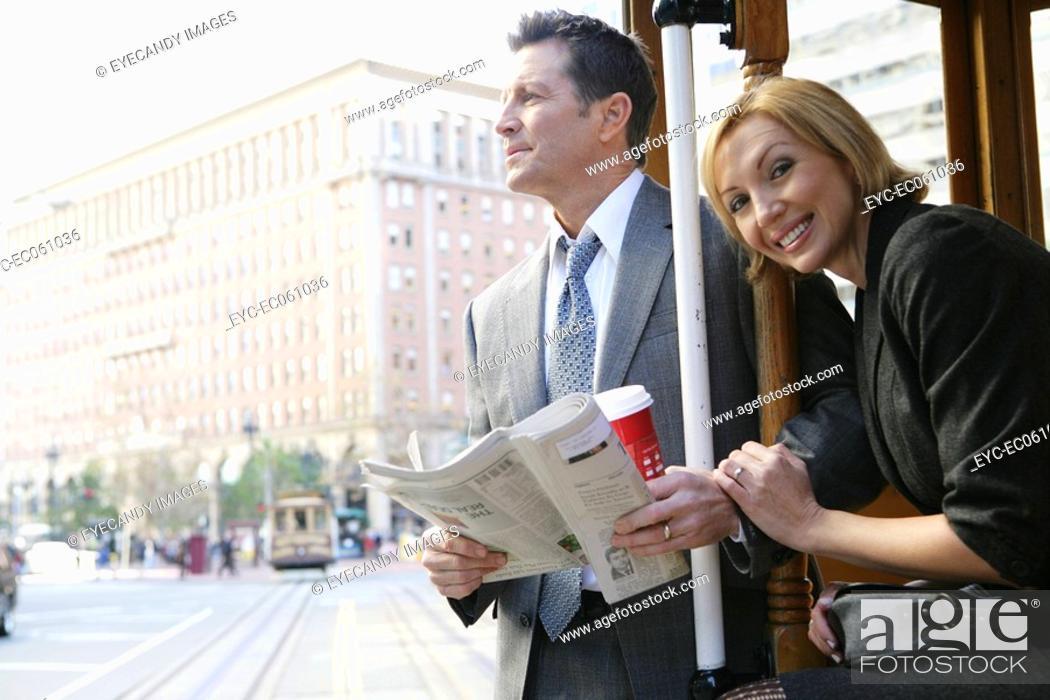Stock Photo: Couple riding a trolley car.