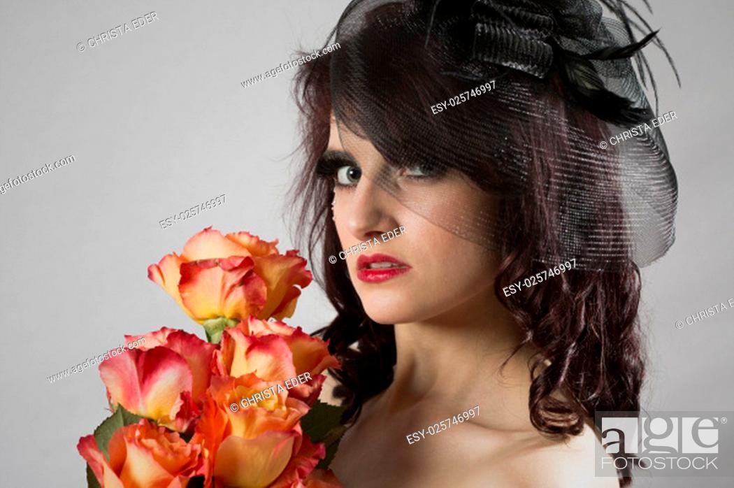 Stock Photo: burlesqueportrait a perfectly made and styled young woman with roses.