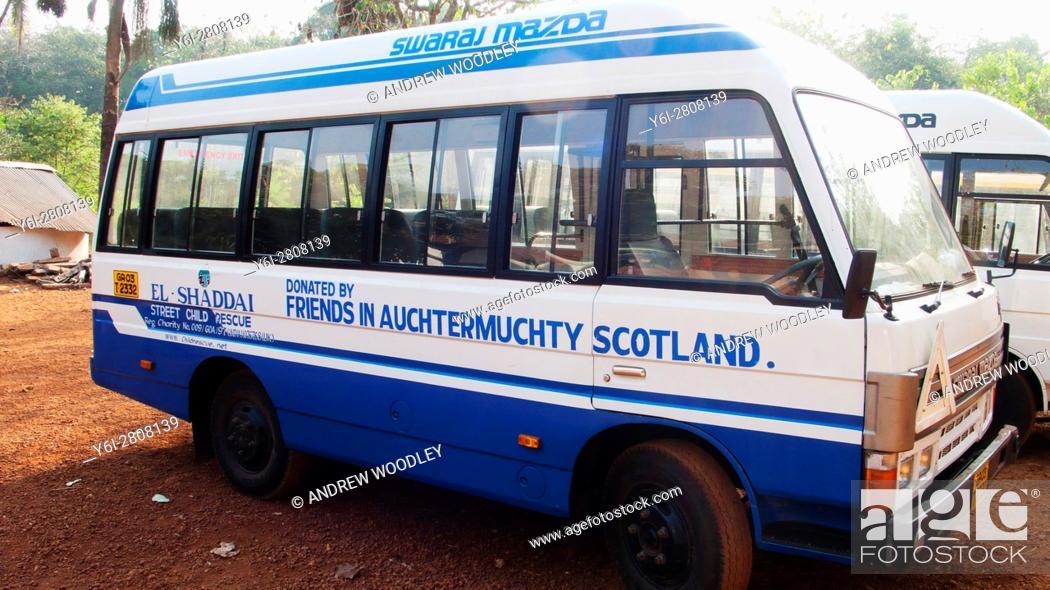 Stock Photo: Donated charity bus El Shaddai Street Child Rescue near Mapusa Goa India.