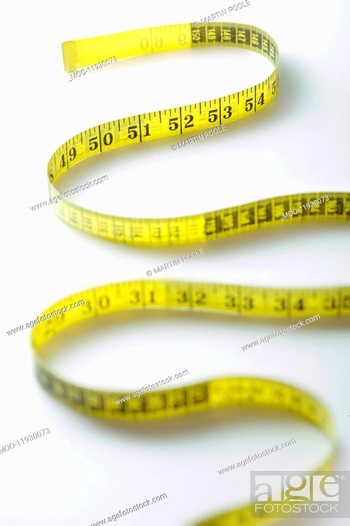 Stock Photo: Winding strip of measuring tape close-up.