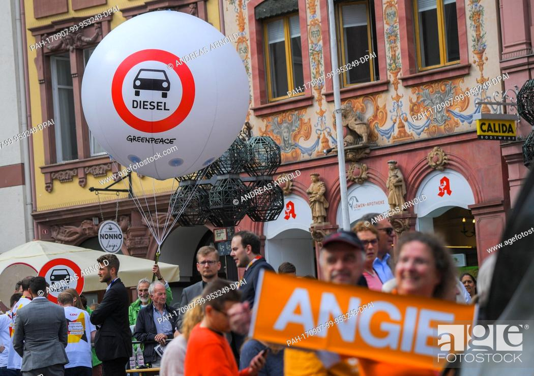 Stock Photo: The environmental organisation Greenpeace protests against the Diesel policies before the event of the German chancellor with a giant balloon in Mainz, Germany.