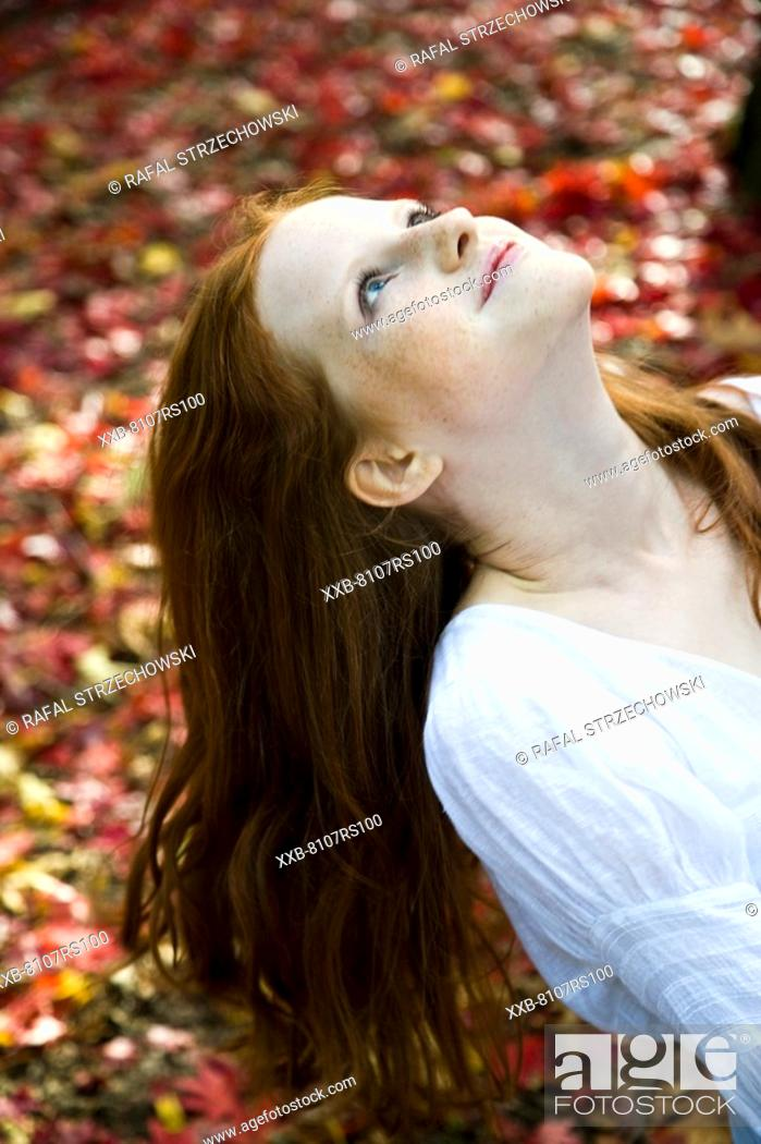Stock Photo: Ginger woman relaxing in park.