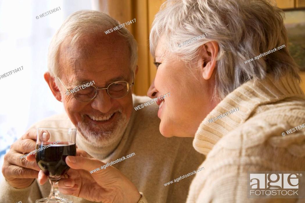 Stock Photo: Senior couple holding wine glasses.
