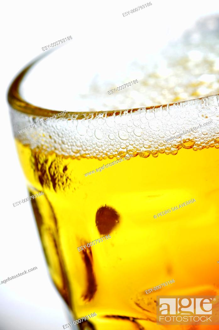 Stock Photo: foreground of a refreshing pitcher of beer.