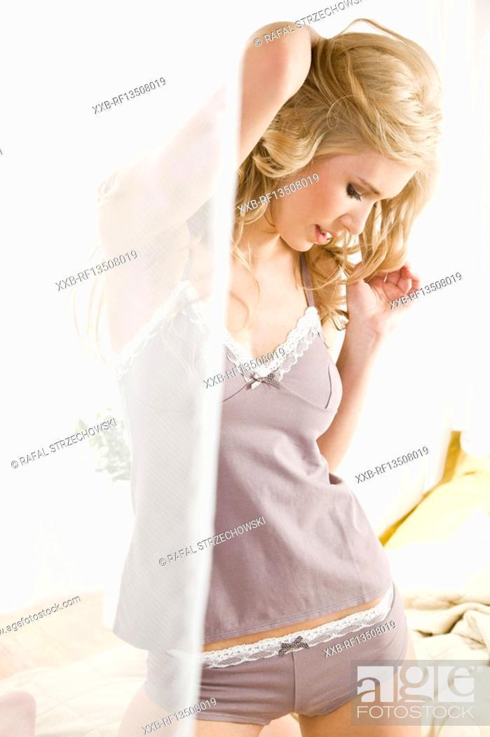 Stock Photo: Beautiful woman in bedroom.