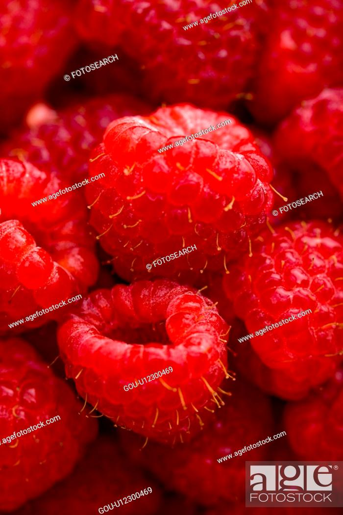 Stock Photo: Close up of red raspberries.