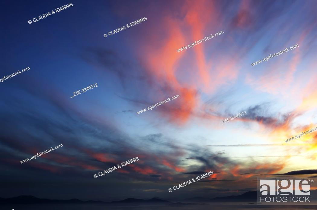Stock Photo: Sunset over the Pagasitic Gulf, Thessaly, Greece, with the mountains of the Greek mainland in the background.