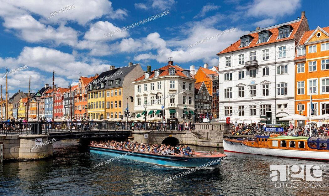 Stock Photo: Excursion boat, Nyhavn canal, Copenhagen, Denmark.
