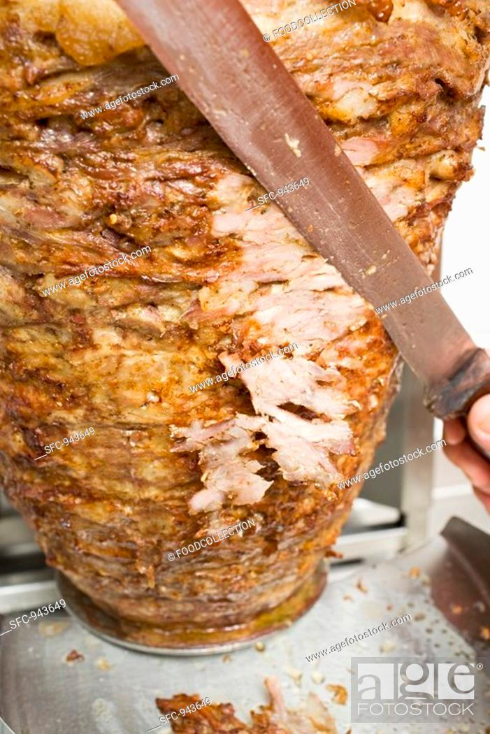Stock Photo: Slicing döner meat from the spit.