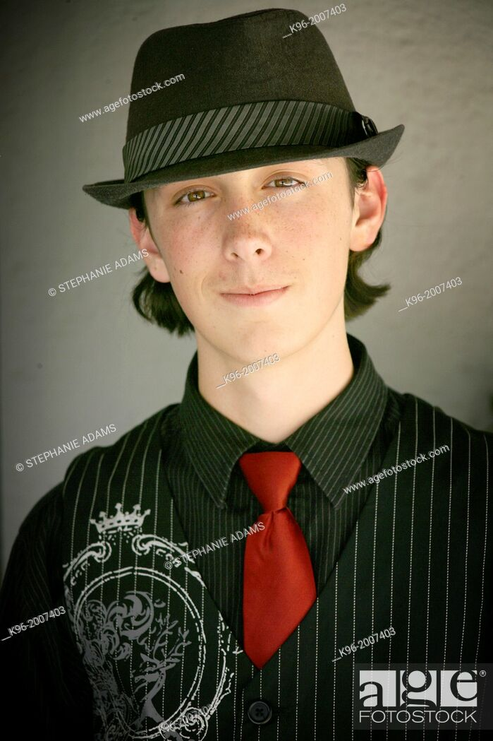 Photo de stock: Teenager in fedora hat and red tie.