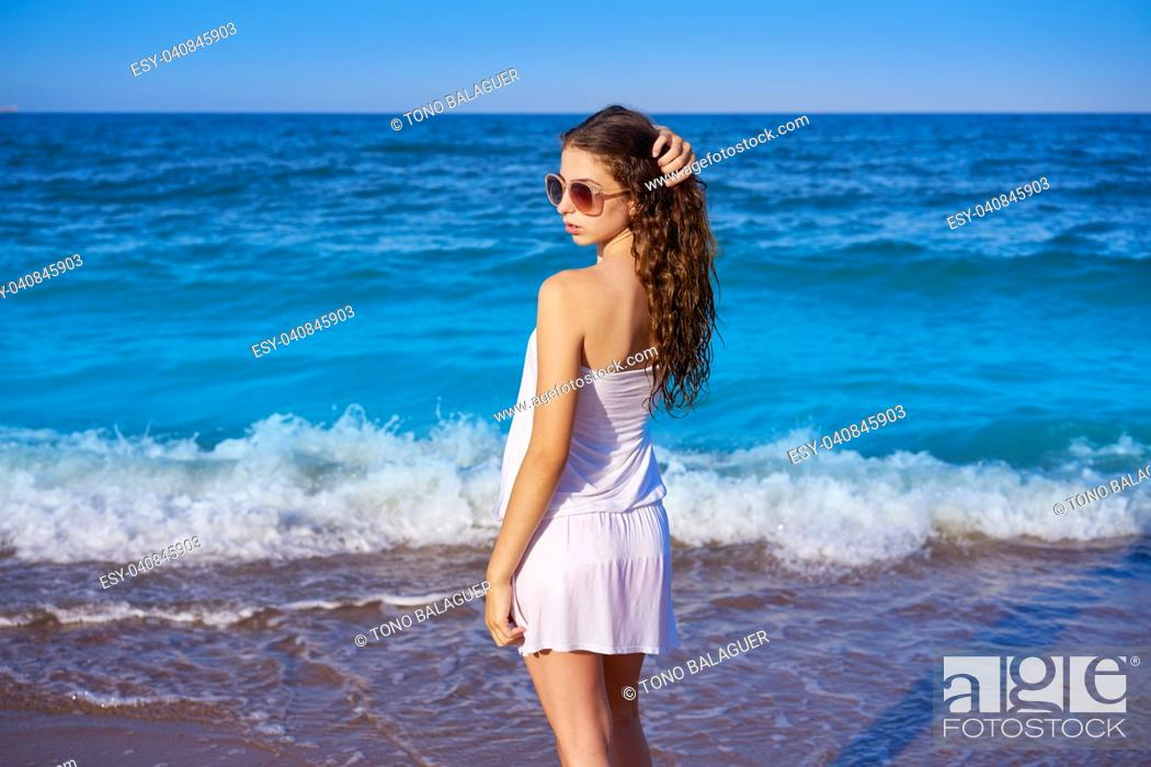Stock Photo: Girl in beach sea shore with summer white dress.