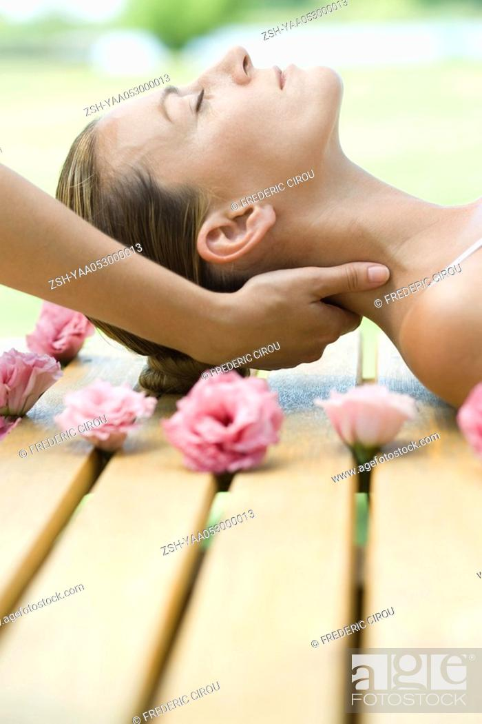 Stock Photo: Woman receiving neck massage.