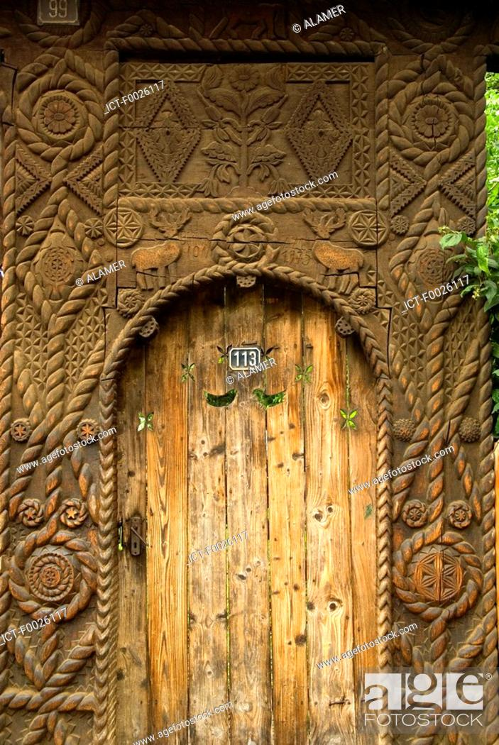 Stock Photo: Romania, Maramures, close-up of carved door.