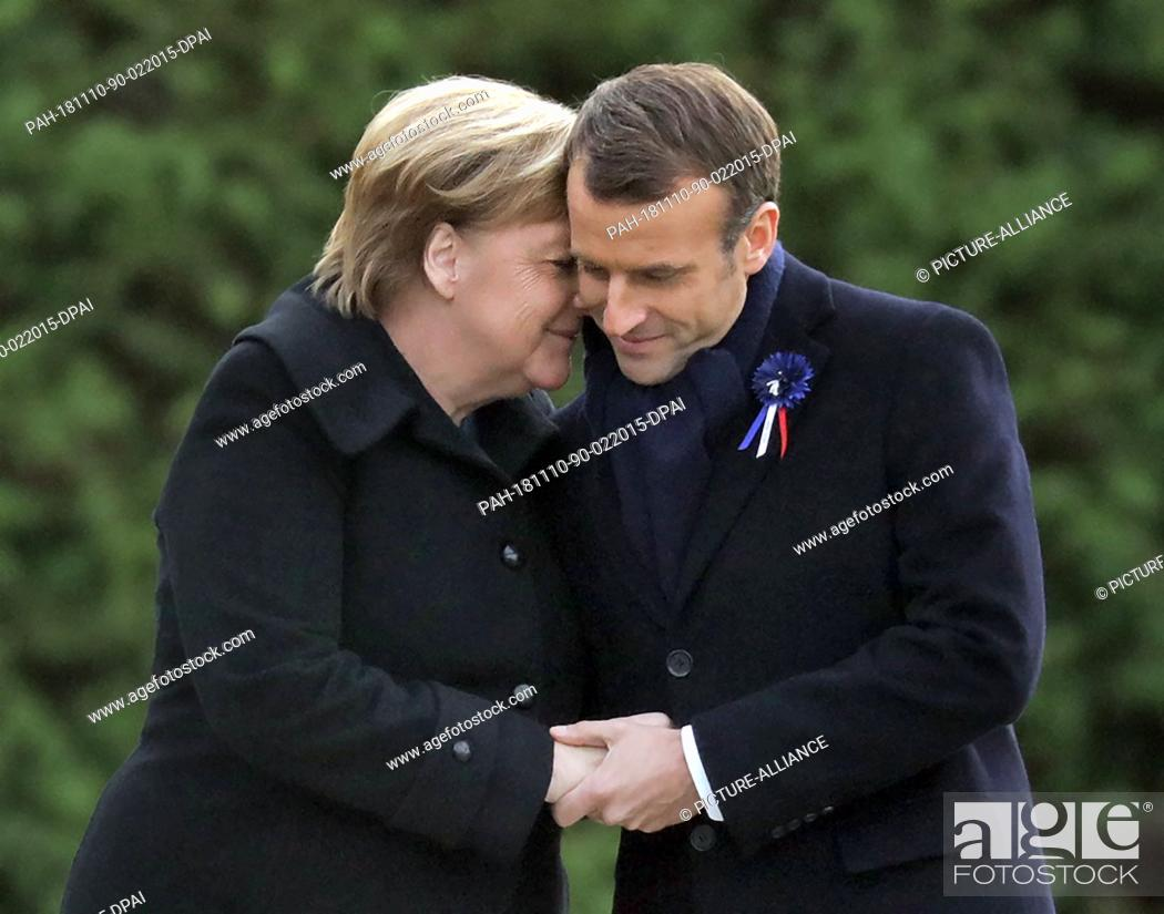 Stock Photo: 10 November 2018, France, Compiegne: German Chancellor Angela Merkel (CDU) and French President Emmanuel Macron commemorate the end of the First World War 100.