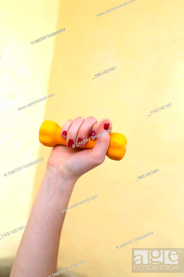 Stock Photo: Dumbbell in hand - fitness working out exercise health  Indoors.