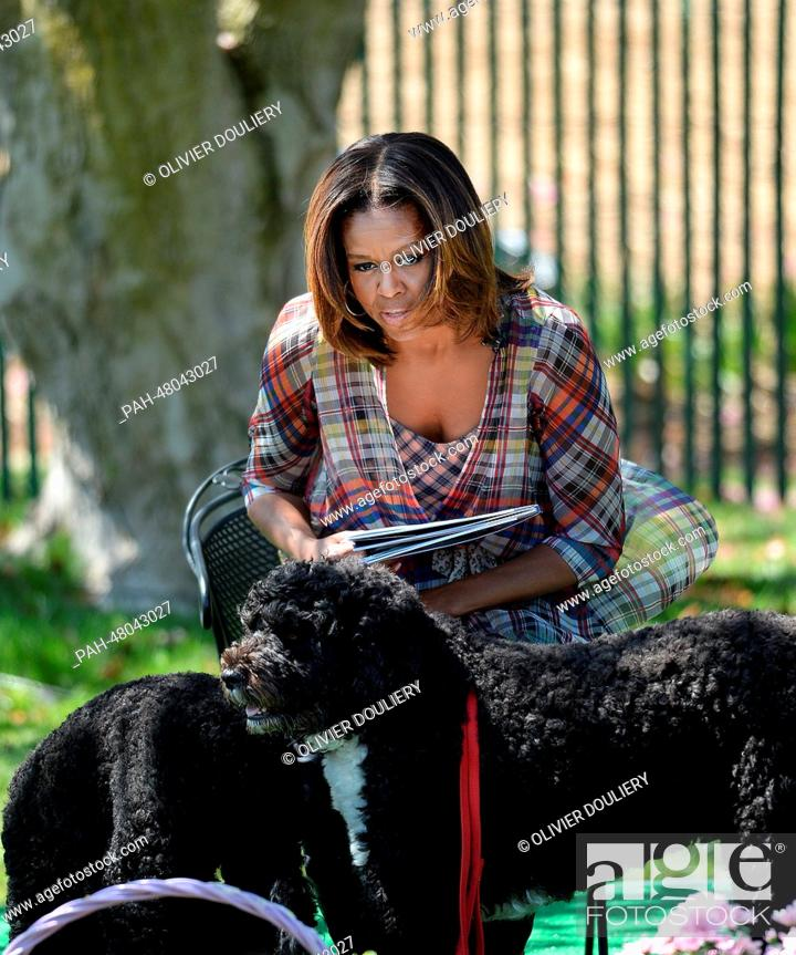 United States first lady Michelle Obama with her dogs, Bo