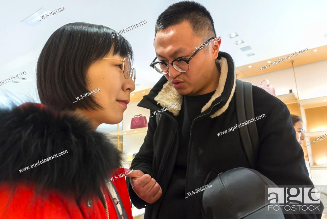 Stock Photo: Nice, France, Chinese Tourists, Shopping, Louis Vuitton LVMH luxury CLothing Store.