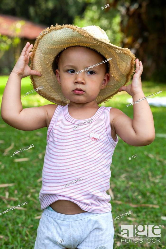 d5c69648f 2 year old boy outdoors with cowboy hat, Stock Photo, Picture And ...