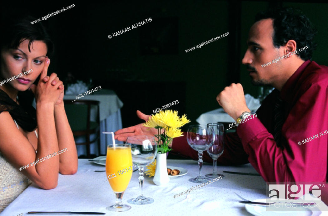 Stock Photo: couple arguing in a restaurant.