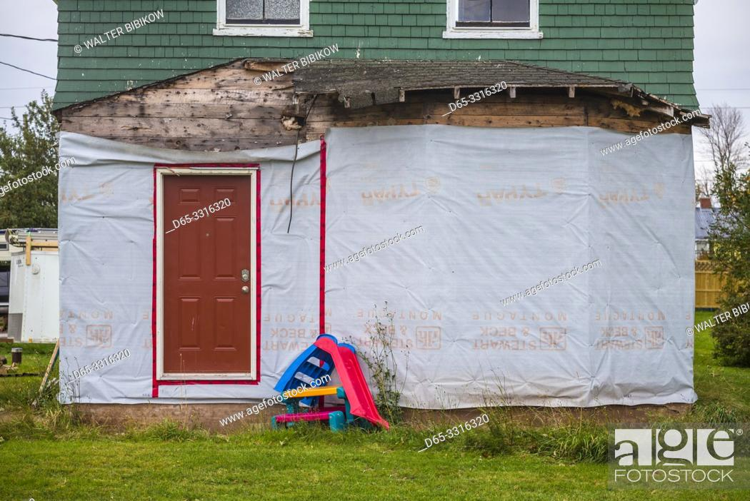 Imagen: Canada, Prince Edward Island, Georgetown, house under cosnstruction with plastic children's toys.