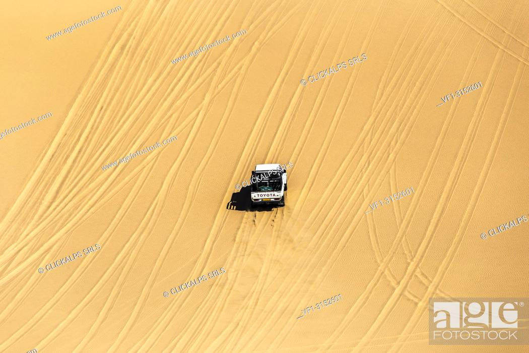 Stock Photo: Offroad vehicle driving on the sand dunes,Sandwich Harbour, Namib Naukluft National Park,Namibia,Africa.