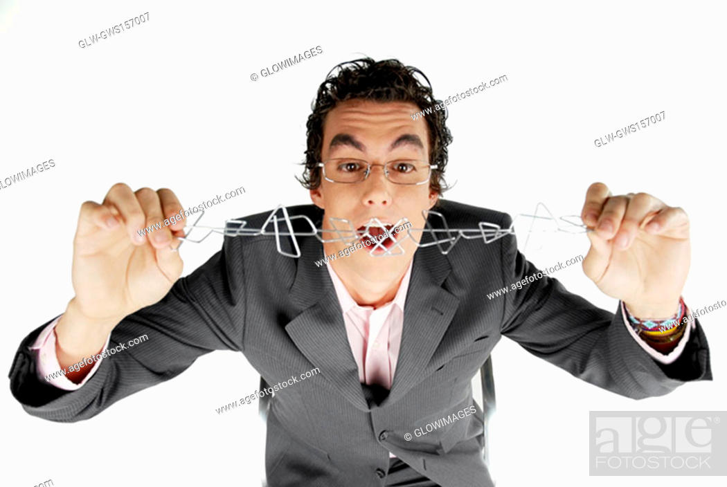 Stock Photo: Close-up of a businessman holding a chain of paper clips.