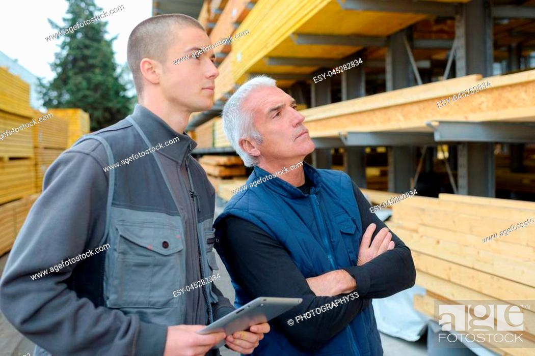 Stock Photo: inspecting the wooden planks.