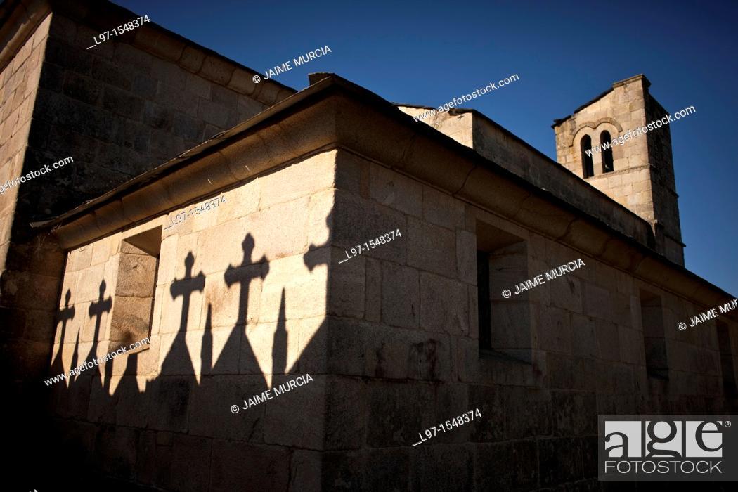 Stock Photo: Shadows of crosses on the wall of Iglesia de Santiago, village of Barbadelo along the Camino de Santiago.